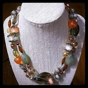 Multicolored and antique gold necklace